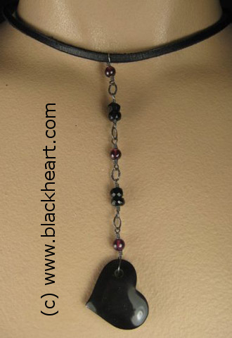 Limited edition choker with black heart pendant, made by Joan's sister Anne Larkin